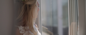 Bride looking out of window.