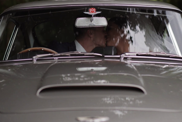 Couple In Wedding Car by Award Winning Wedding Videographer